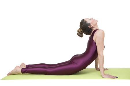 Woman practicing yoga in the cobra pose Banco de Imagens
