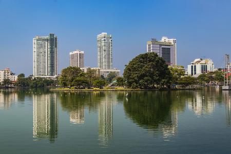 COLOMBO, SRI LANKA - JANUARY 18, 2014: View at Beira lake at Gangaramaya Temple in Colombo, Sri Lanka. Beira Lake is a lake in center of Colombo, Sri Lanka.