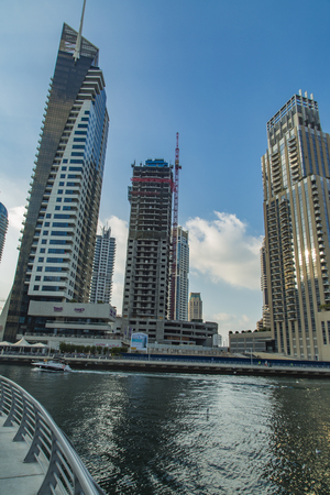 DUBAI, UAE - JANUARY 16, 2014: View at modern skyscrapers in Dubai Marina in Dubai, UAE. When the entire development is complete, it will accommodate more than 120,000 people. Editorial