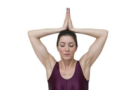 Woman doing yoga pose Sukhasana isolated on white background Stock Photo