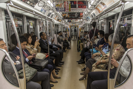 TOKYO, JAPAN - OCTOBER 12, 2016: Unidentified people in Tokyo subway train. Tokyo subway have 13 lines and 8,7 millions of passengers daily.