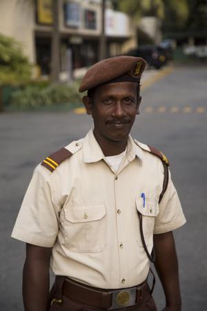 NEGOMBO, SRI LANKA - JANUARY 20, 2014: Unidentified man on the street of Negombo, Sri Lanka. Negombo is the fourth largest city in Sri Lanka.