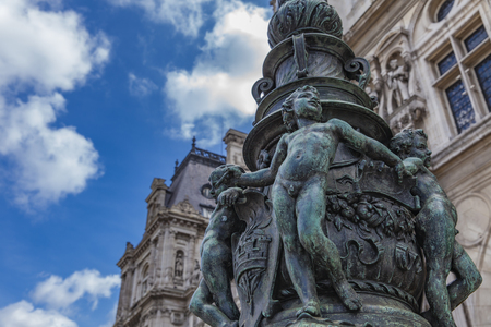 Detail of decorative lamp post in front of Hotel de Ville (City Hall) in Paris, France
