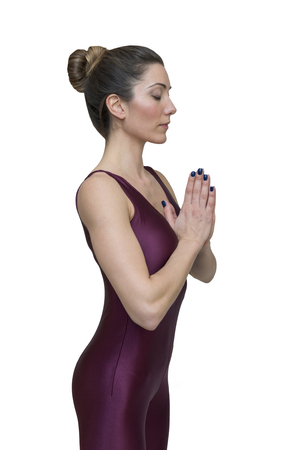 Woman practicing yoga in salutation position Imagens - 80972884