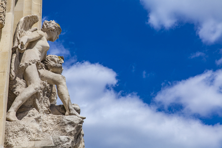 View at architectural detail on stone sculptures of two angels at Grand Palais in Paris