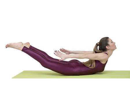 Woman practicing yoga in locust pose isolated on the white background 版權商用圖片