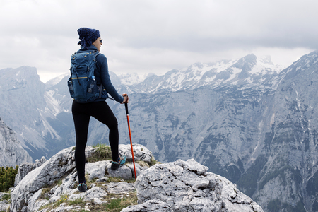 Female standing on the top of the mountain with beautiful panorama Stock Photo
