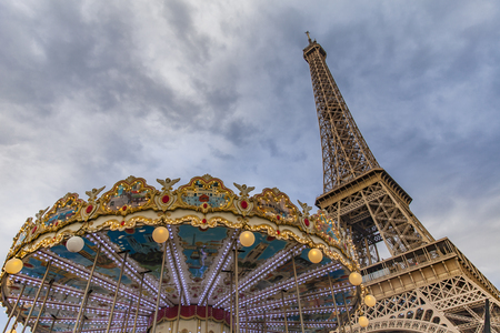 View at vintage carousel and Eiffel tower in Paris, France