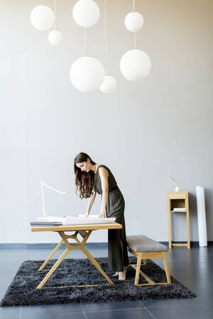 Young woman works on a project in a modern room