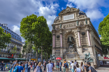 PARIS, FRANCE - JUNE 16, 2017: Unidentified people by Fontaine Saint Michel in Paris, France. Fountain was constructed in 1858–1860 by architect Gabriel Davioud Éditoriale