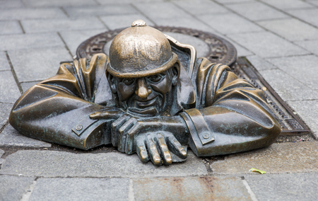 BRATISLAVA, SLOVAKIA - JUNE 16, 2017: Statue Man at work in Bratislava, Slovakia. This bronze statue of sewer worker was created in 1997 by Viktor Hulik.
