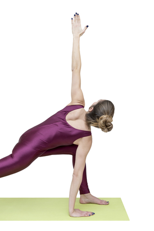Woman practicing yoga in revolved side angle pose Stock Photo