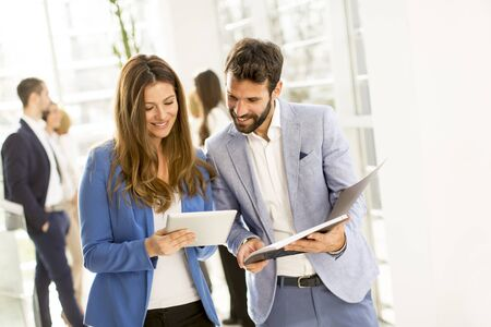 Young bussiness couple with tablet in the office Stock Photo
