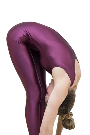 女性は足の位置に手でヨガの練習 写真素材