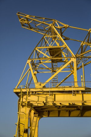 Closeup detail of the yellow dock crane