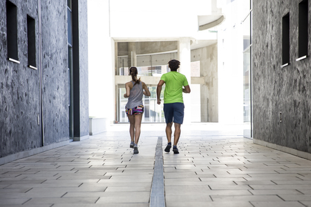 Young couple practicing jogging in the city