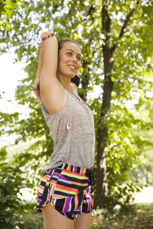Young woman practicing in the park at the summer day Stock Photo