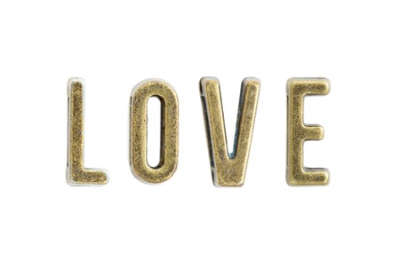 Vintage copper letters forming word love isolated on the white background 版權商用圖片