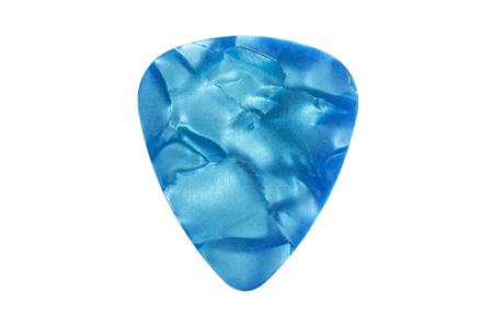 Colorful guitar pick isolated on the white background Foto de archivo