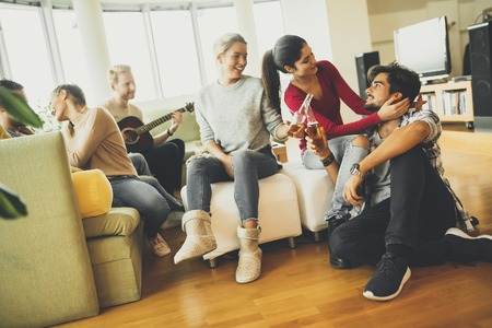 Group of young people have a fun at home