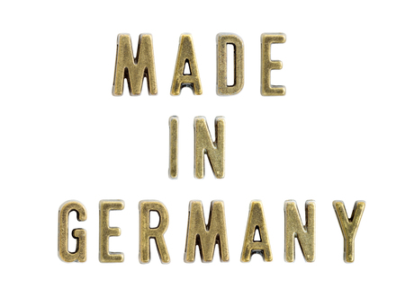 Vintage copper letters forming text made in Germany isolated on the white background