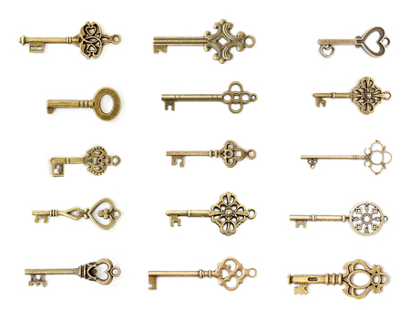 View at vintage metal keys set isolated on the white background