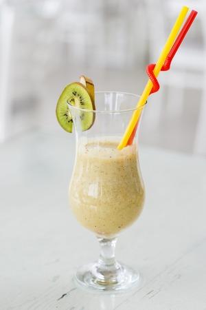 lose up view at healthy smoothies made from kiwi and banana