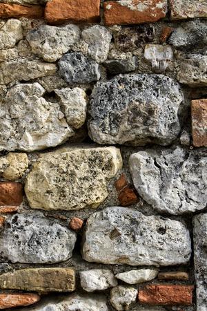오래 된 돌 담에서 근접 촬영보기 스톡 콘텐츠
