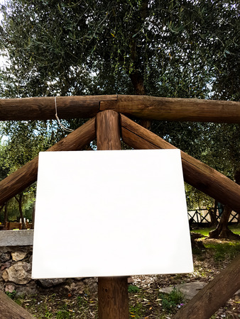 Blank outdoor white board hanging on the fence