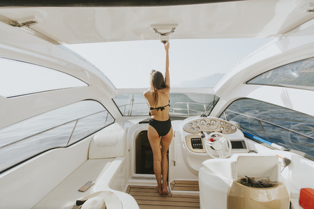 Young woman on the yacht at sea