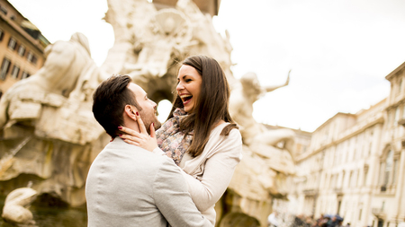 View at loving couple in Rome , Italy
