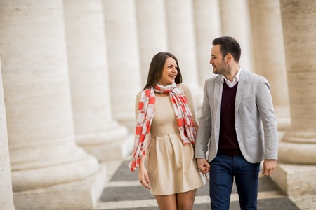 Loving couple at the St. Peter's Square in Vatican, Italy Stock Photo