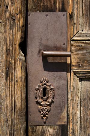 Close up view at old wooden entrance door with antique door handle