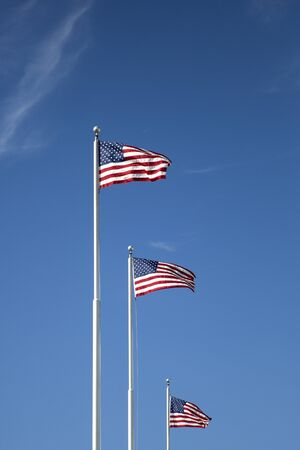 View at American flags on the blue sky