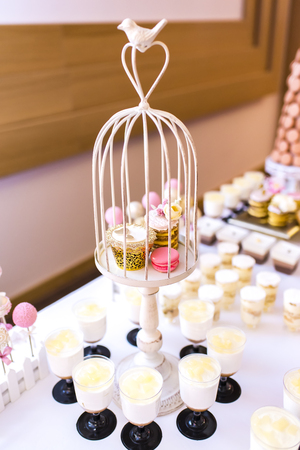 Elegant and luxurious event arrangement with colorful pastries Фото со стока