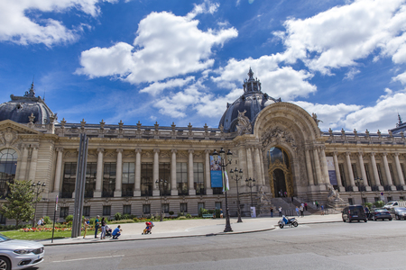 PARIS, FRANCE - JUNE 16, 2017: Unidentified people by Petit Palaise in Paris, France. Petit Palais was built for the 1900 Exposition Universelle.
