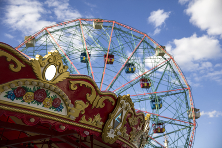 View at the vintage ferris wheel under blue sky