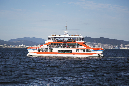 MIYAJIMA, JAPAN - OCTOBER 10, 2016: Detail from Miyaima ferry port in Japan. Famous for its ancient temples, island  welcomes 4 million visitors per year.