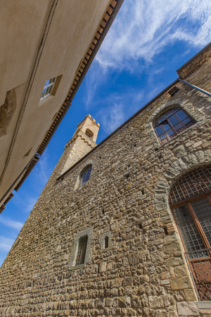 View at narrow street in Montalcino, Italy on a sunny day