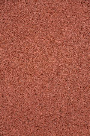 クローズ アップ ビューで赤い小石石のテクスチャ 写真素材