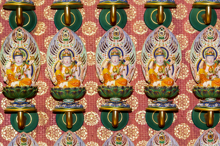 SINGAPORE - AUGUST 6, 2014: Detail from Buddha Tooth Relic Temple in Singapore. Temple is based on the Tang dynasty architectural style and was established at 2002.