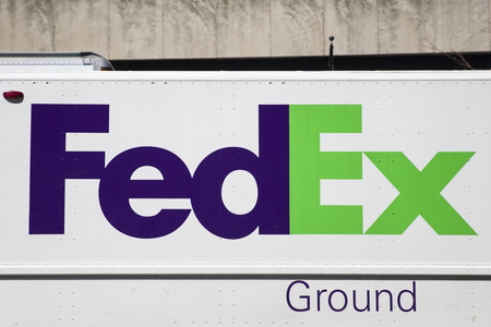 NEW YORK, USA - AUGUST 30, 2017: Detail from FedEx truck in New York, USA. FedEx Corporation is an American multinational courier delivery services company from Memphis, Tennessee, founded at 1971.