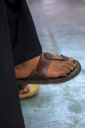 Close up view at man wearing sandals 版權商用圖片