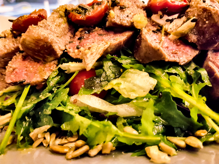 Close up view at beefsteak with green salad Reklamní fotografie