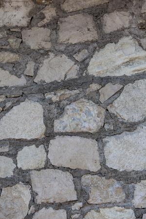 Close up view at stacked stone wall