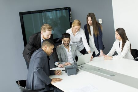 african business: Business team working together in modern office to achieve better results Stock Photo