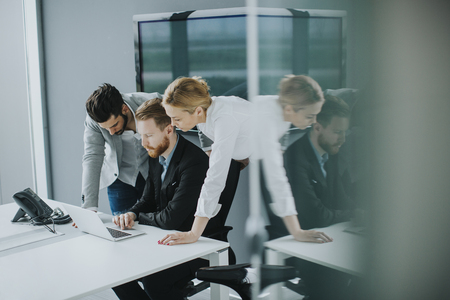 Group of business people at a meeting  in modern office Imagens