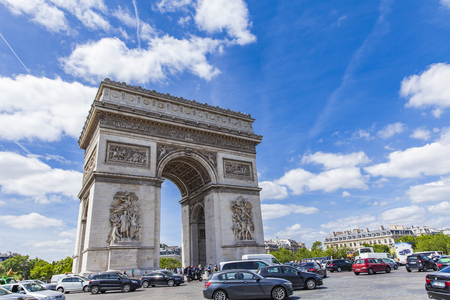 PARIS, FRANCE - JUNE 16, 2017:'Traffic around Arc de Triomphe in Paris, France. It  is one of the most famous monuments in Paris.