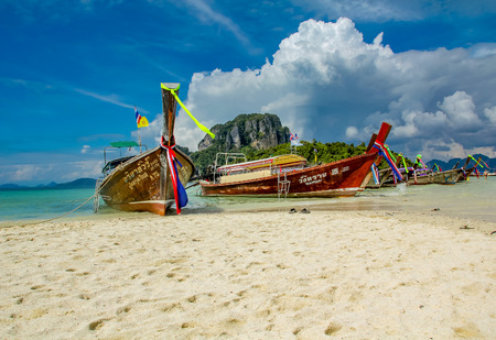 KRABI, THAILAND - JANUARY 3, 2012: Traditional long tail boats at Krabi, Thailand. This long tail boats are now often used to transport tourists.