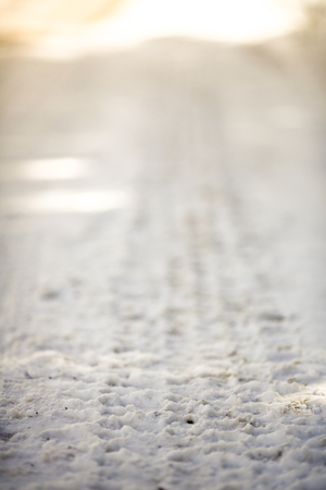 Closeup of the car trail in the snow at winter